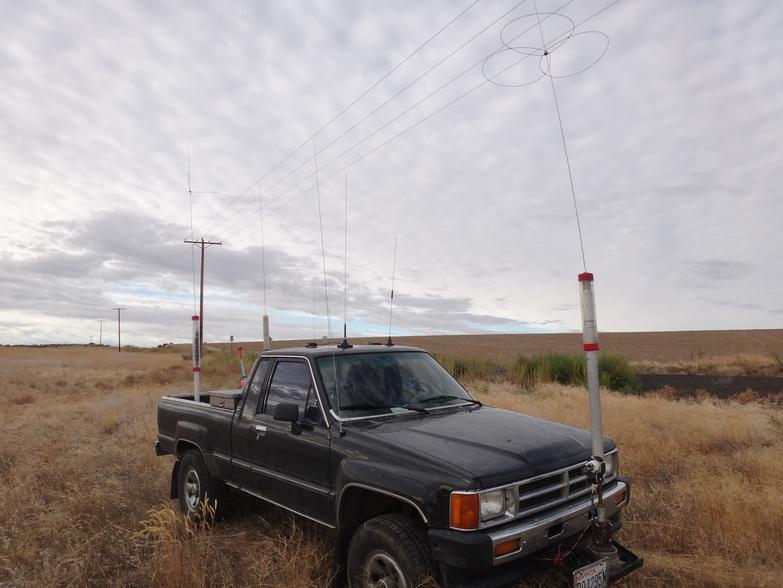 Image of rover parked next to the Yakima (YAK) -- Klikitat (KLI) county line sign.